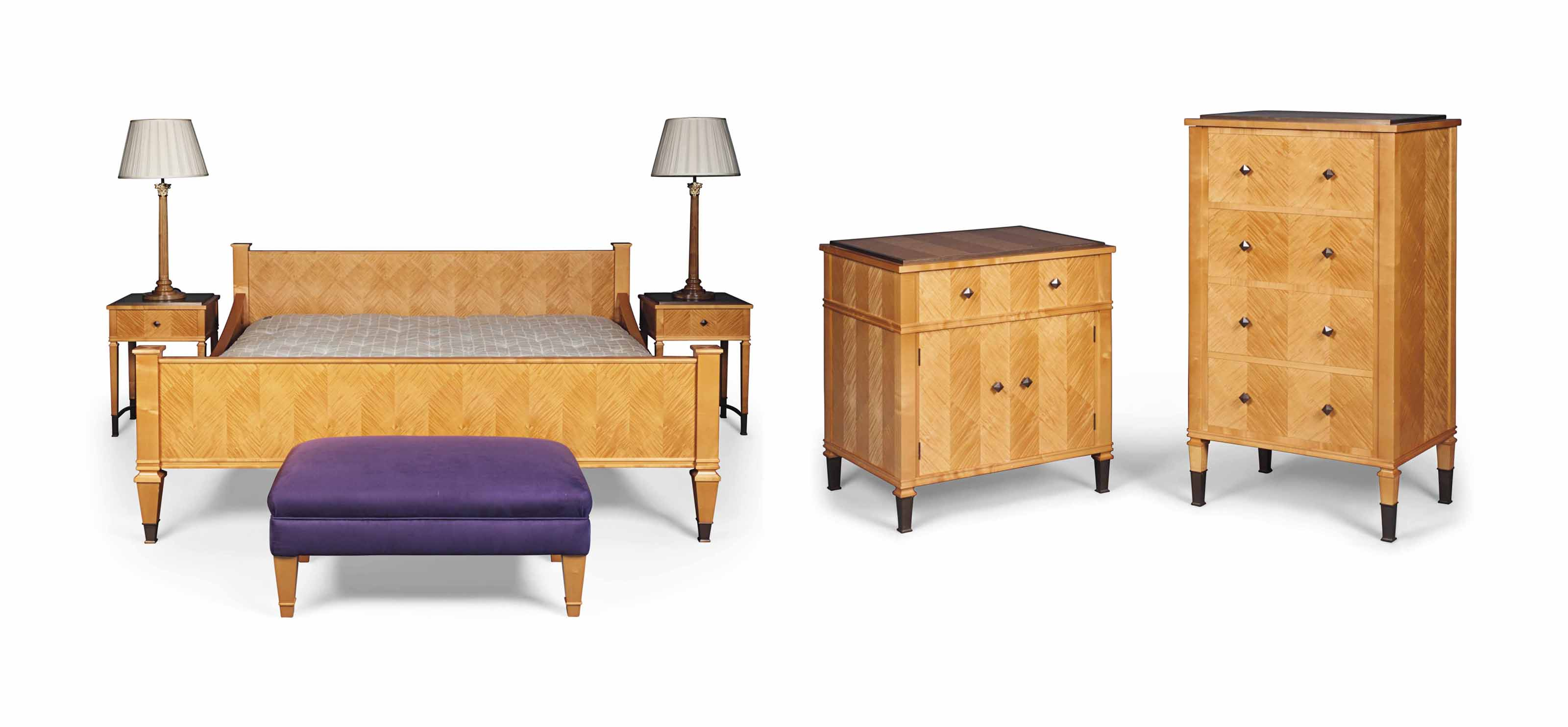 AN ENGLISH MAPLE AND PATINATED BRASS BEDROOM SUITE
