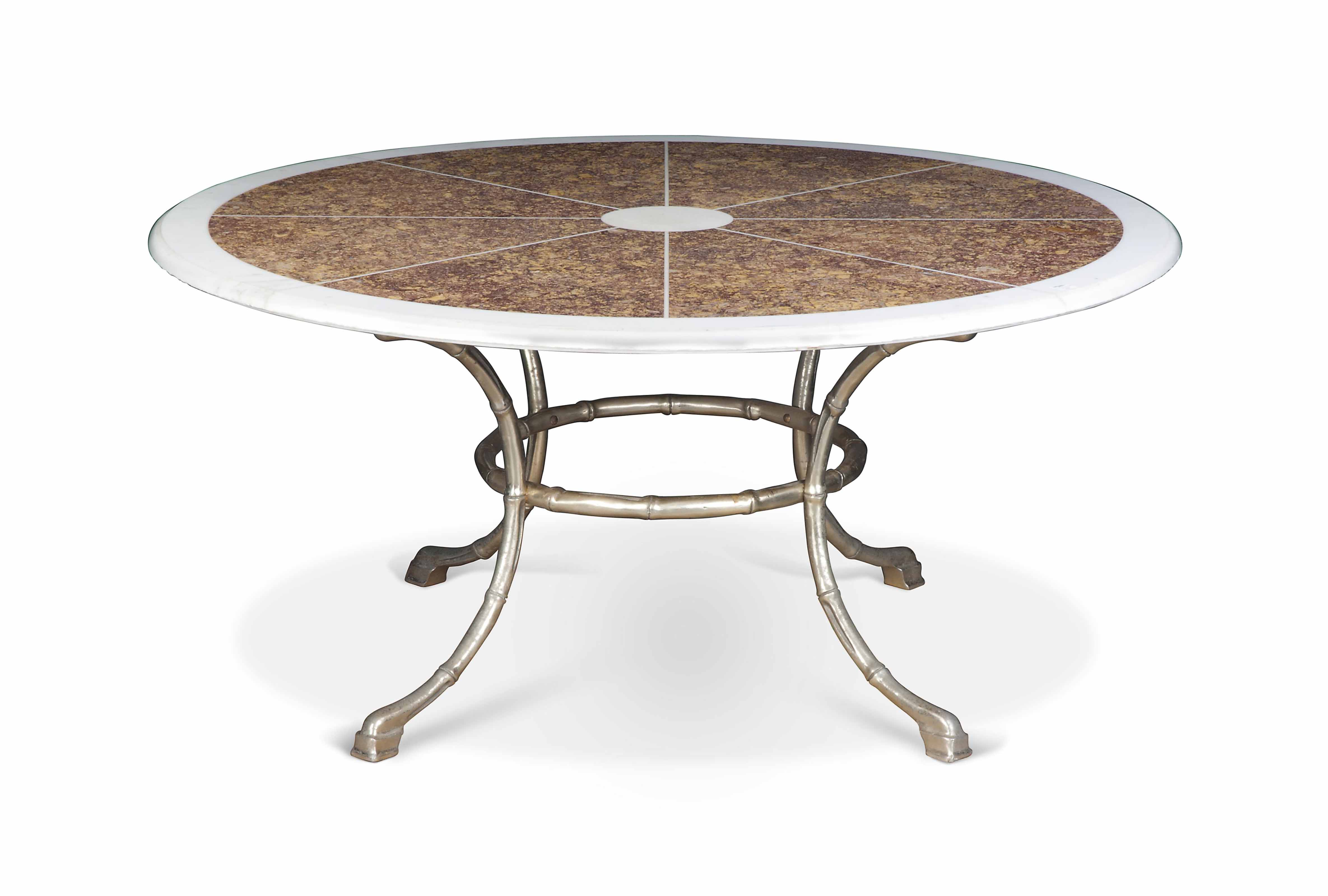 A CIRCULAR MARBLE-TOP TABLE
