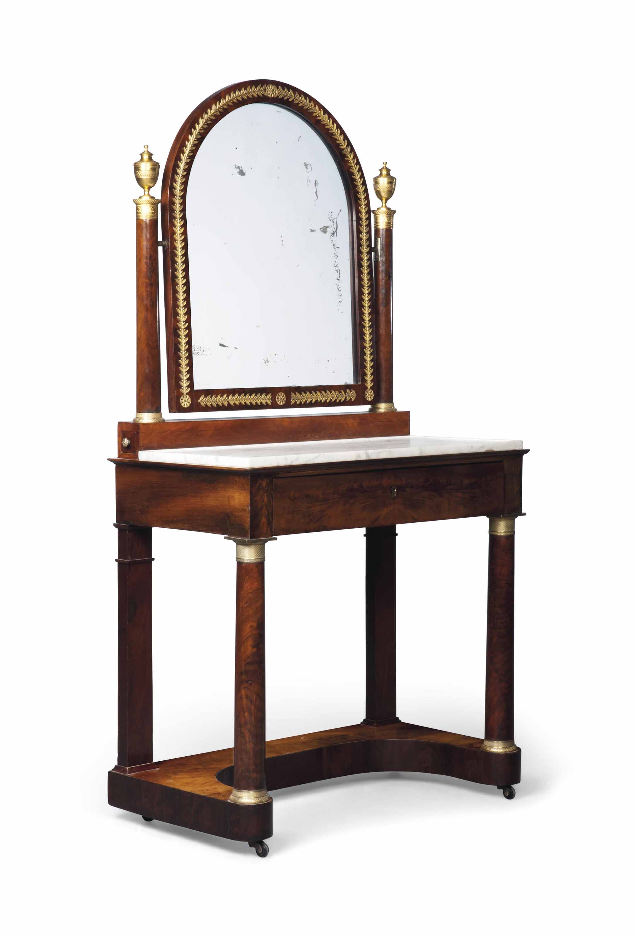 AN EMPIRE ORMOLU-MOUNTED MAHOGANY DRESSING-TABLE