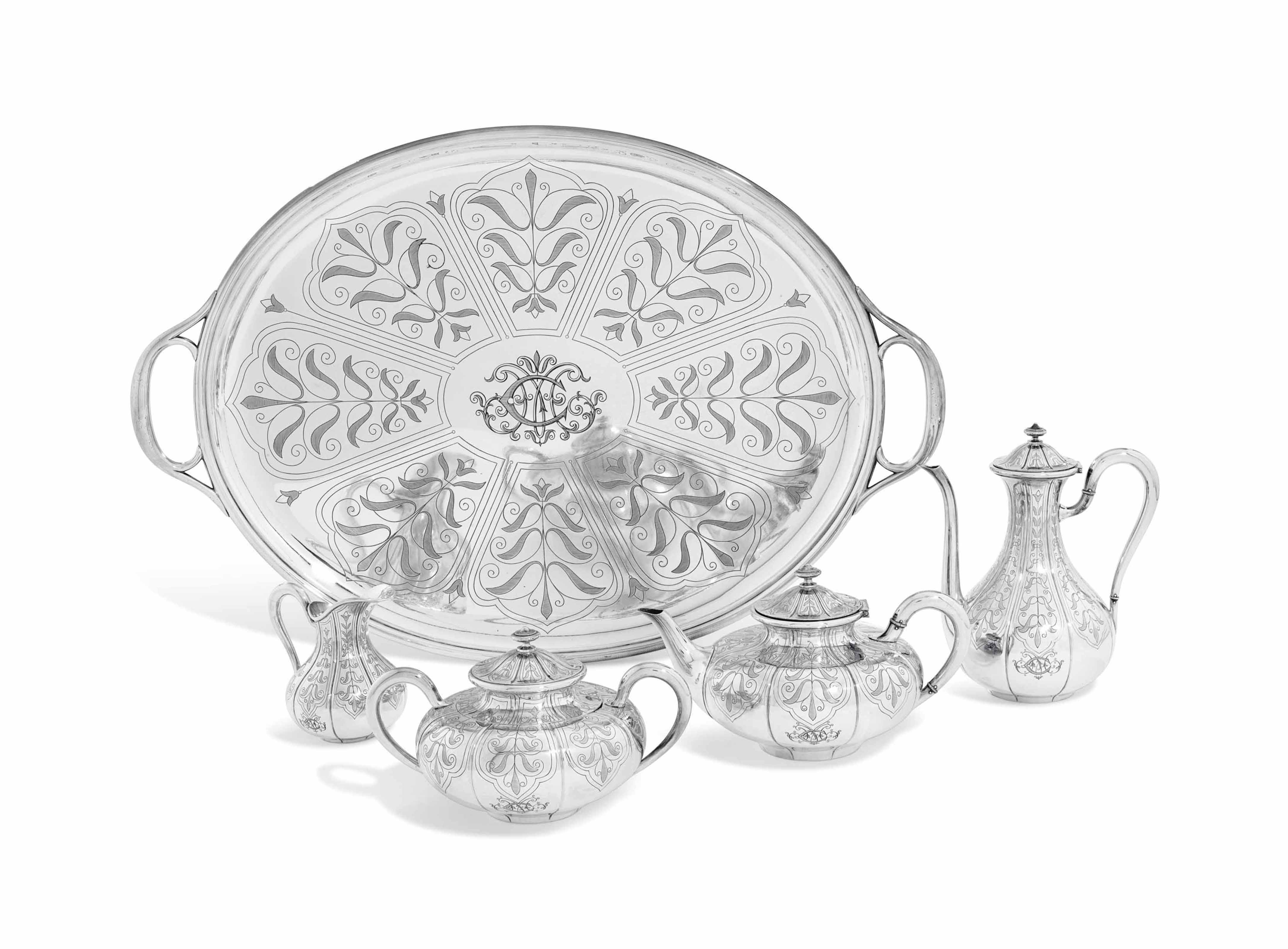 A FRENCH FOUR-PIECE SILVER TEA AND COFFEE-SERVICE WITH SILVER-PLATED TRAY EN SUITE
