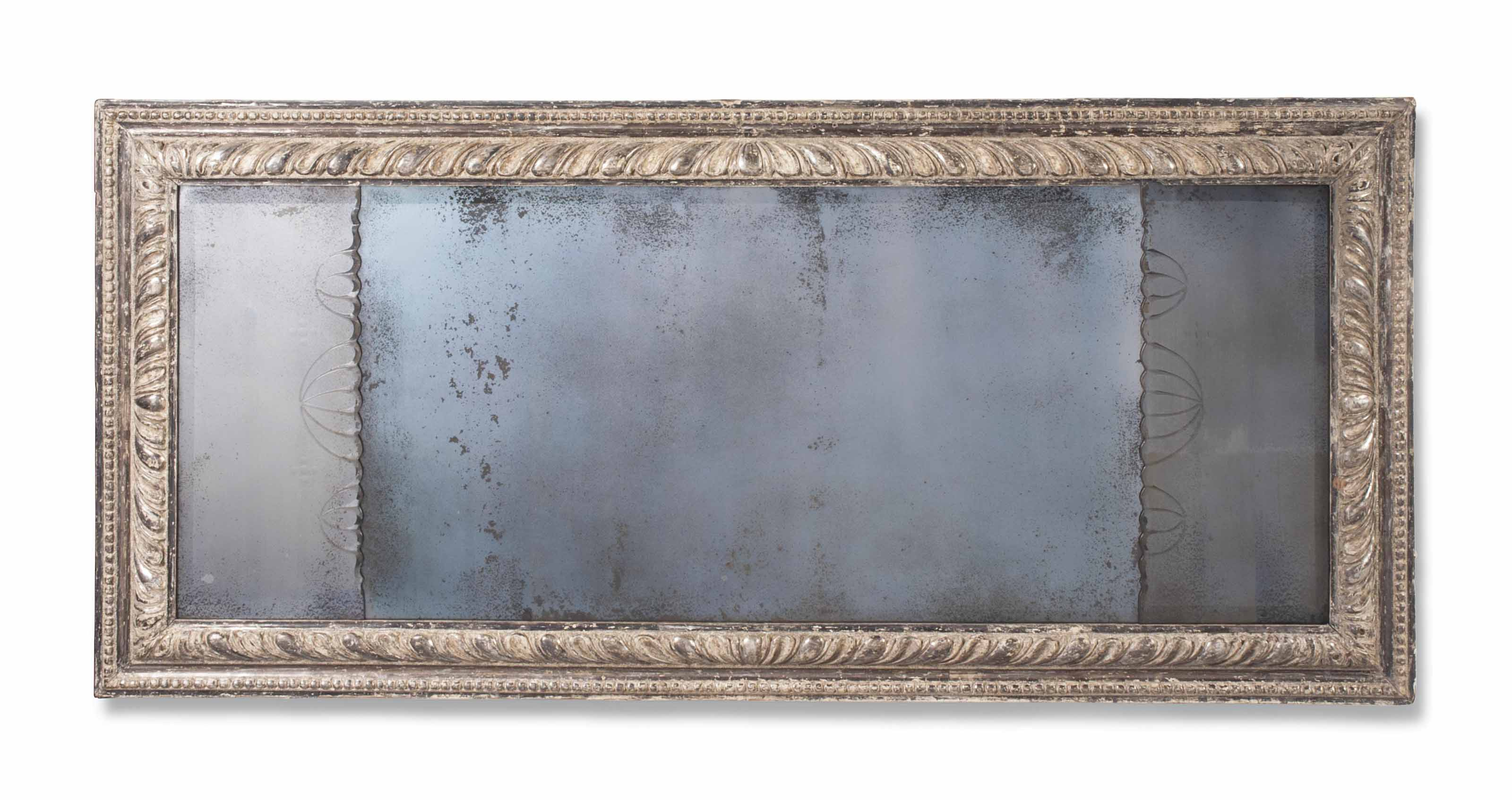 A GEORGE I SILVERED OVERMANTEL