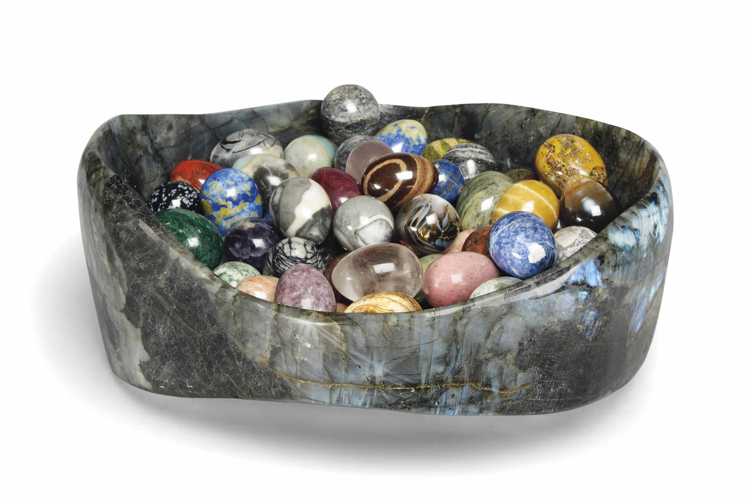 A COLLECTION OF SEVENTY-FIVE MINERAL EGGS IN A LABRADORITE BOWL
