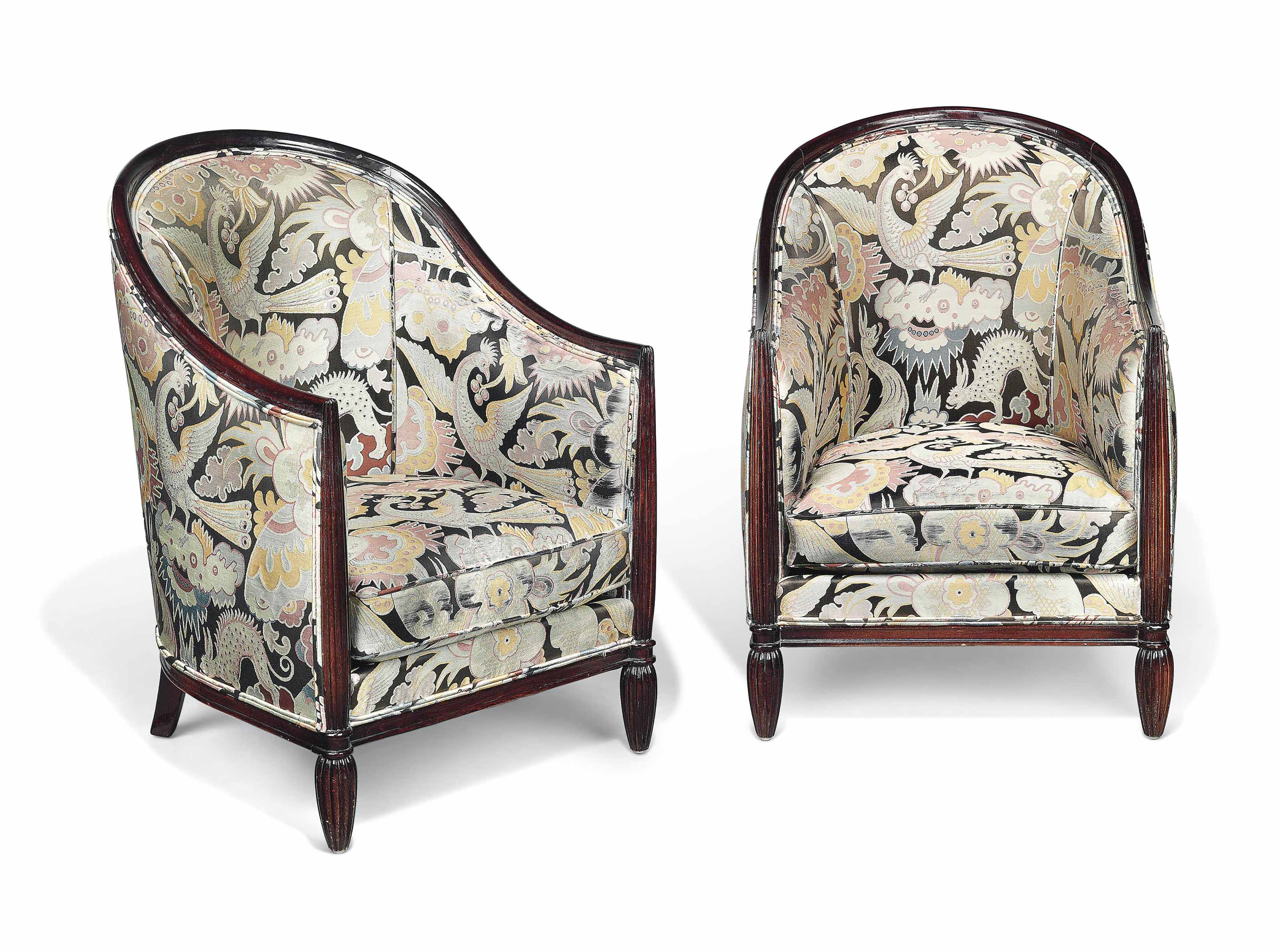 A PAIR OF ART DECO STAINED BEECH AND UPHOLSTERED ARMCHAIRS IN THE MANNER OF PAUL FOLLOT