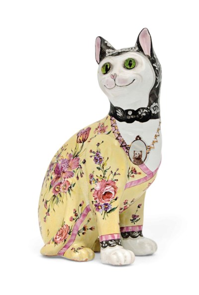 A FAIENCE CAT ATTRIBUTED TO EM