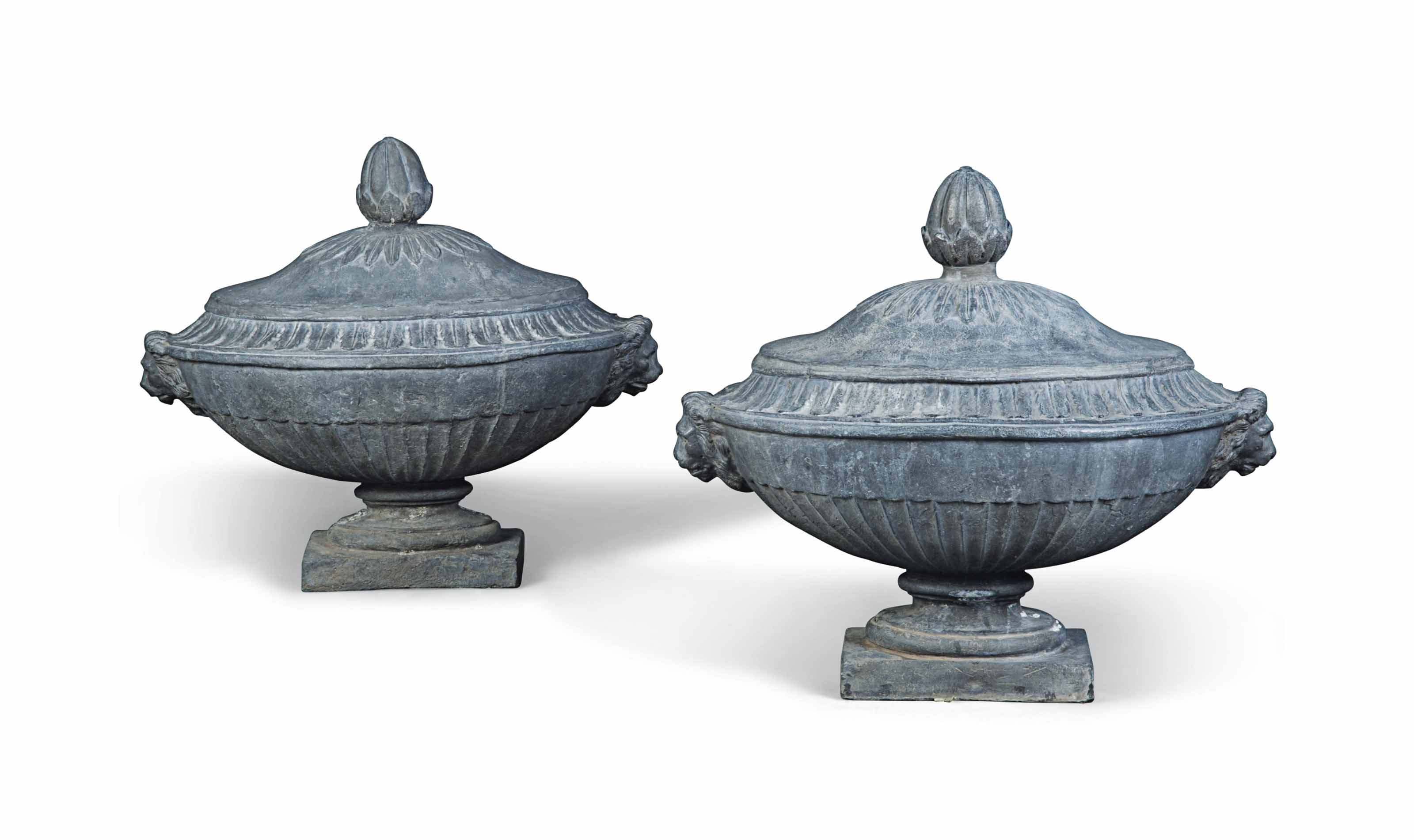 A PAIR OF OVAL LEAD URNS