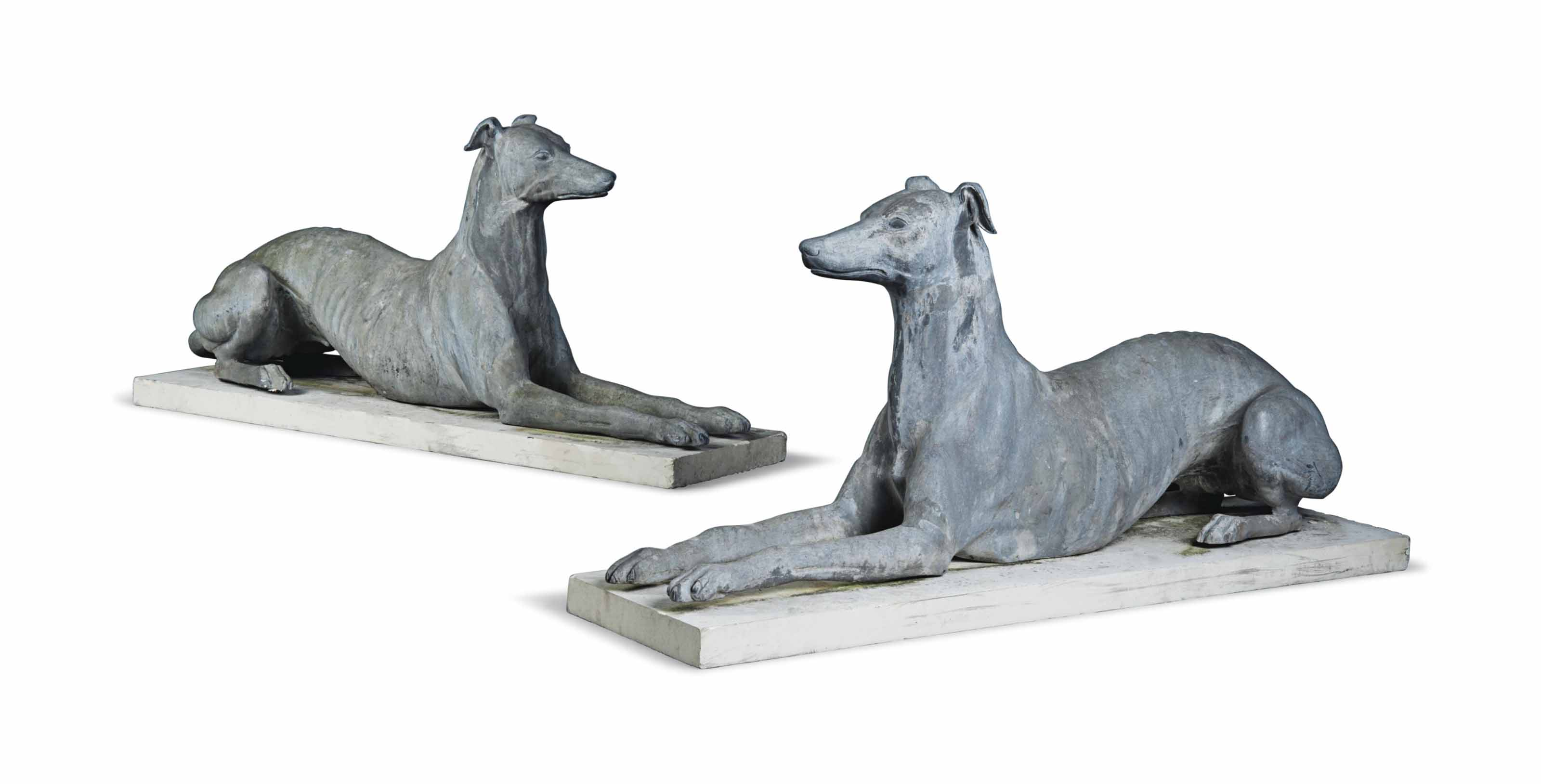 A LIFESIZE PAIR OF LEAD MODELS