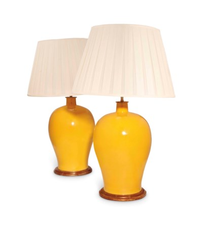 A PAIR OF IMPERIAL YELLOW GLAZ