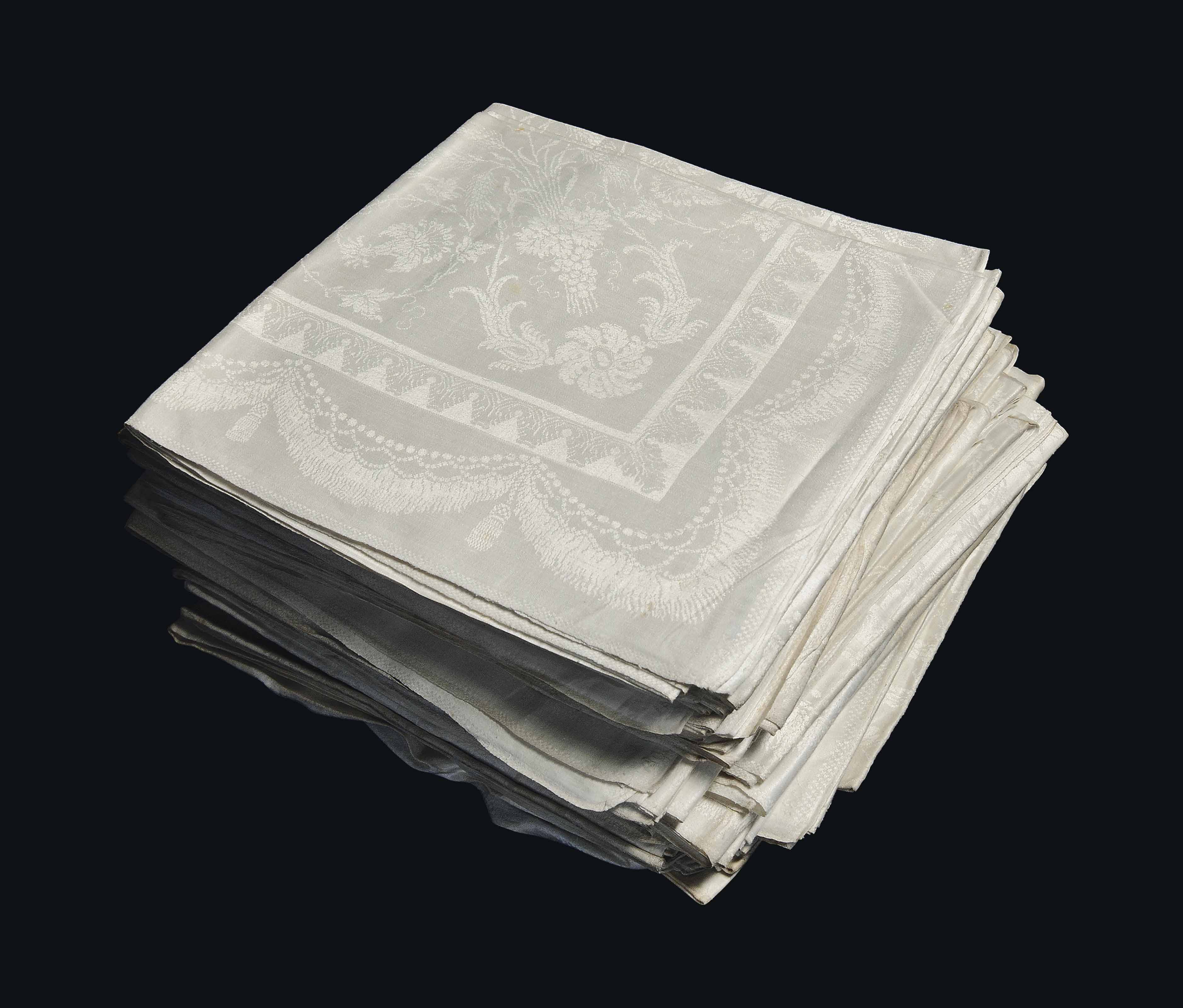 A SET OF FORTY-SIX DAMASK TABL