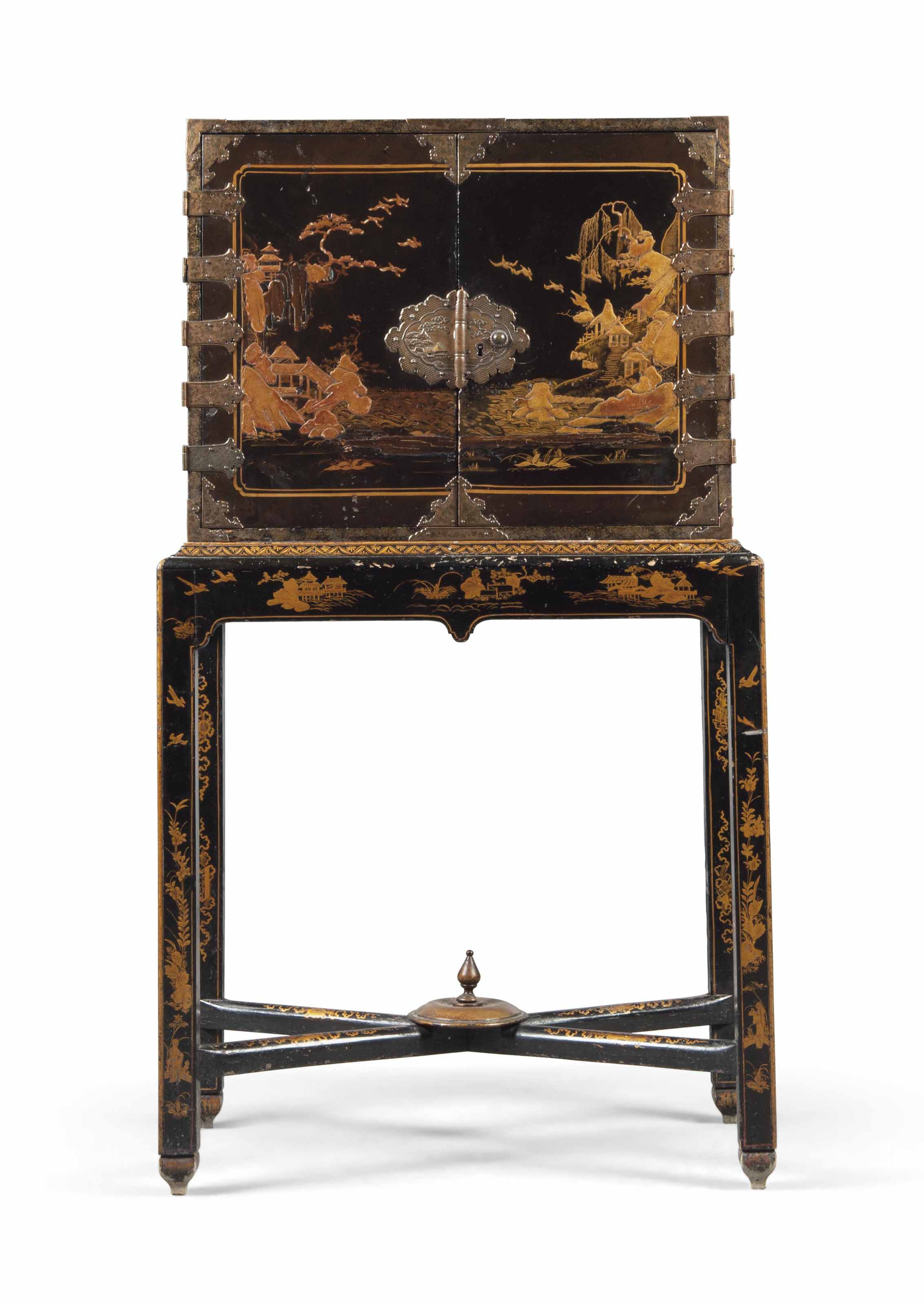 A BLACK AND GILT JAPANNED CABI
