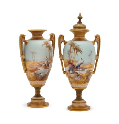 A PAIR OF TWO-HANDLED VASES AN