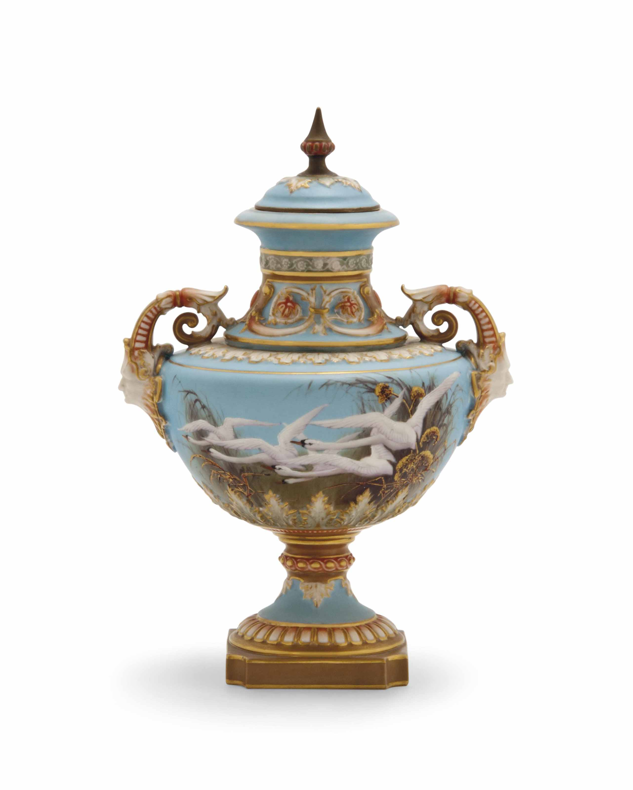 A TWO-HANDLED VASE AND COVER B