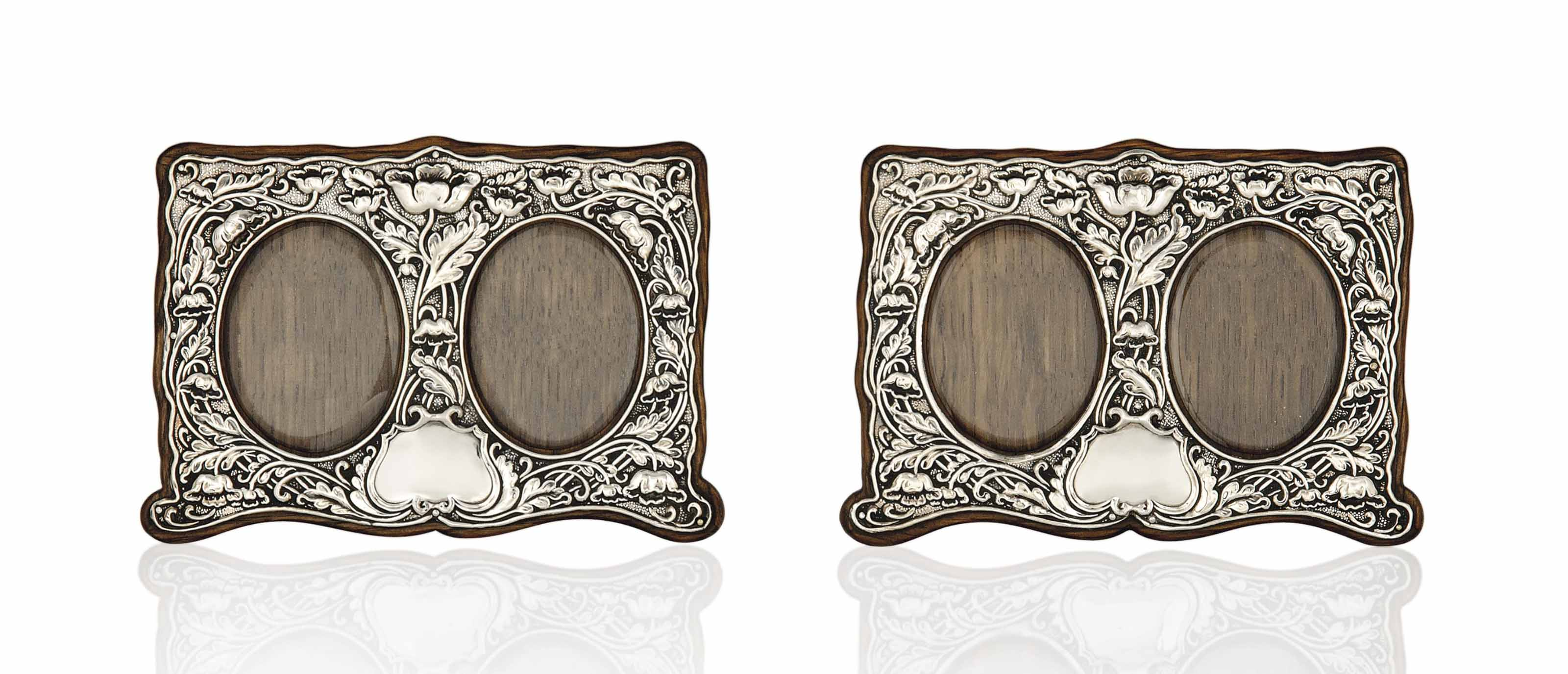 A PAIR OF SILVER AND OAK DOUBL