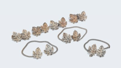 A SET OF SEVEN SILVER CHAINED