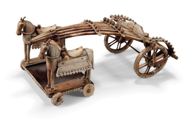AN INDIAN IVORY TOY OF A CART