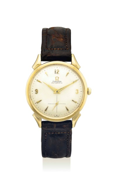 OMEGA. AN ATTRACTIVE 14K GOLD
