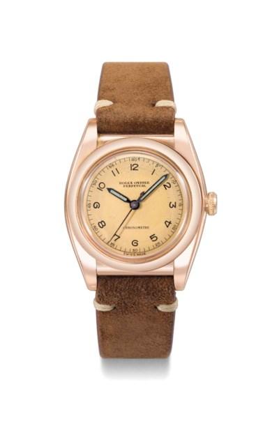 Rolex. A rare 10K pink gold an