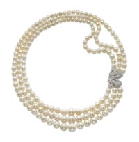 A THREE-STRAND NATURAL PEARL, CULTURED PEARL AND DIAMOND NECKLACE