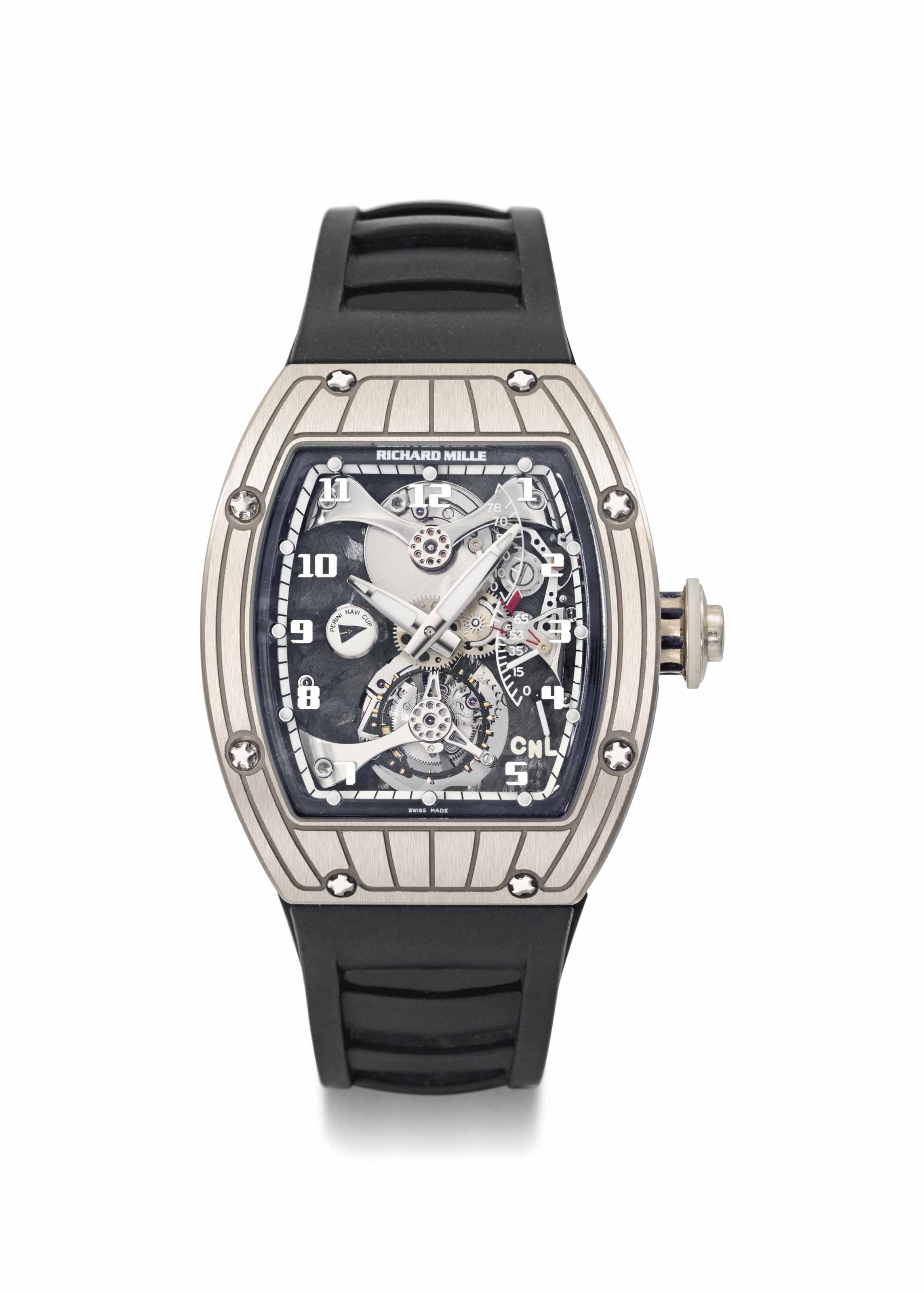 Richard Mille. A fine and very rare 18K white gold skeletonized tourbillon wristwatch with power reserve, function selection, torque indicator with box and warranty