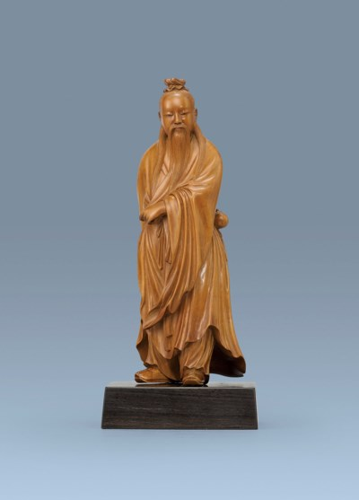 A CARVED BOXWOOD FIGURE OF A S