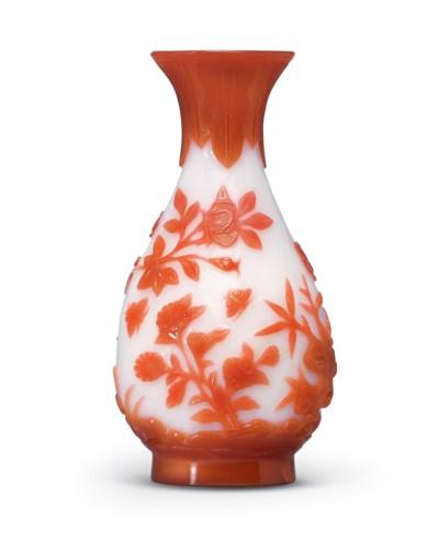 A RED-OVERLAY WHITE GLASS VASE