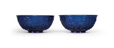 A PAIR OF BLUE GLASS BOWLS