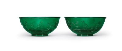 A PAIR OF GREEN GLASS BOWLS