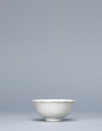 A WHITE-GLAZED FLOWER-FORM CUP