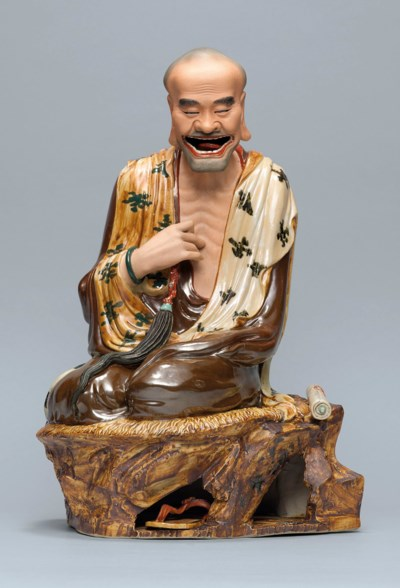 AN ENAMELLED AND PAINTED FIGUR