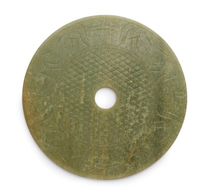 A CARVED GREEN JADE DISC, BI