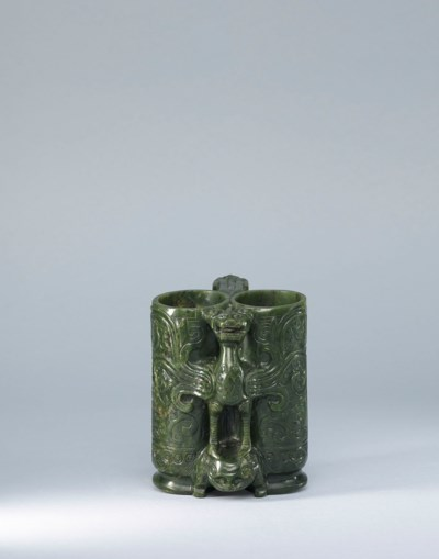 A CARVED SPINACH-GREEN JADE 'C