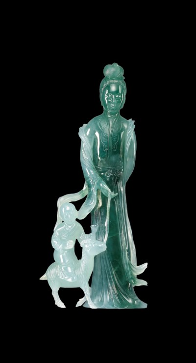 A JADEITE CARVING OF A LADY AN