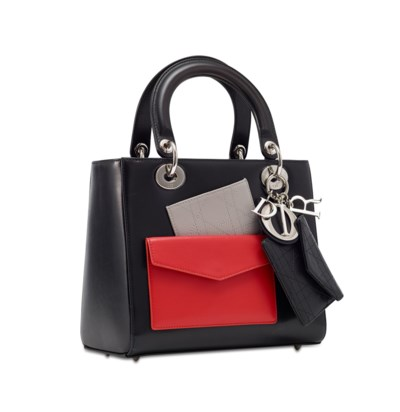 A BLACK LAMBSKIN LEATHER RED P