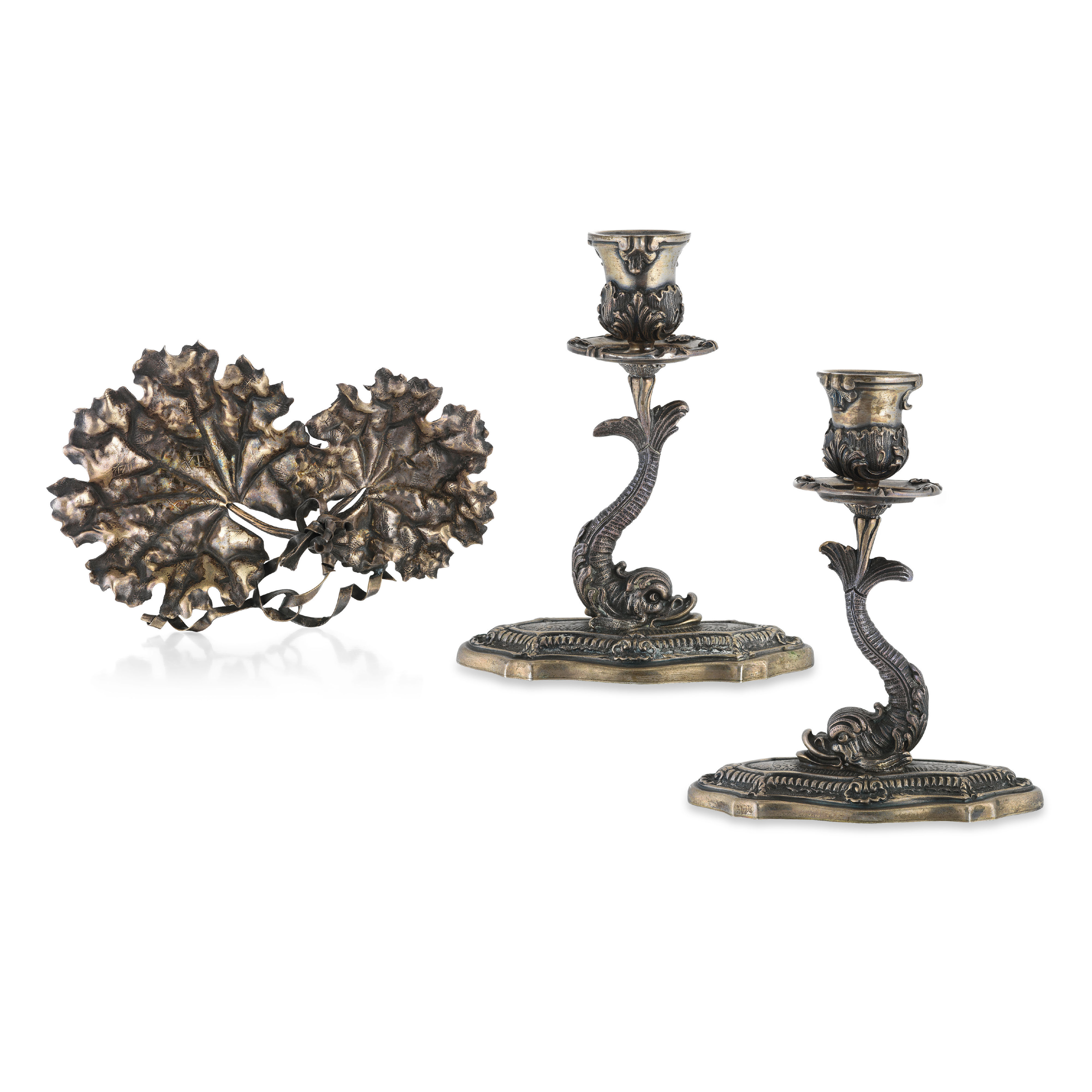 A PAIR OF SILVER CANDLESTICKS