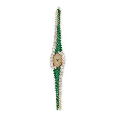 AN EMERALD AND DIAMOND WATCH,