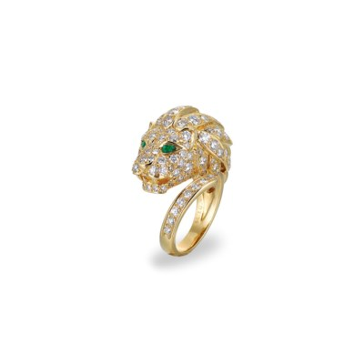 A DIAMOND AND EMERALD RING, BY