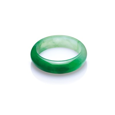 AN IMPORTANT JADEITE BANGLE