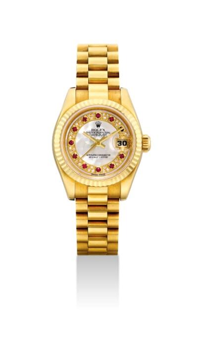 ROLEX. A LADY'S FINE 18K GOLD,