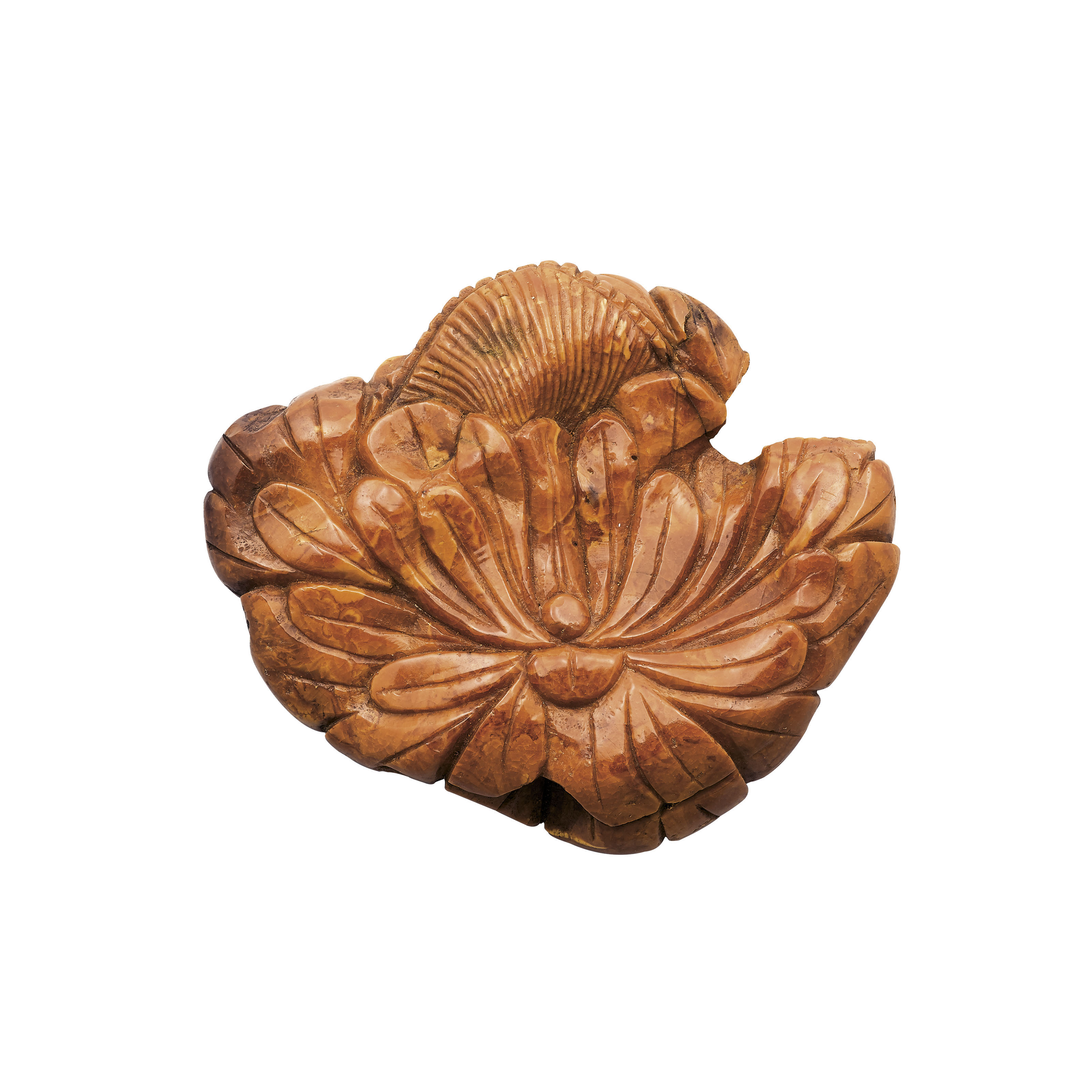 A LARGE AMBER FLORAL CARVING