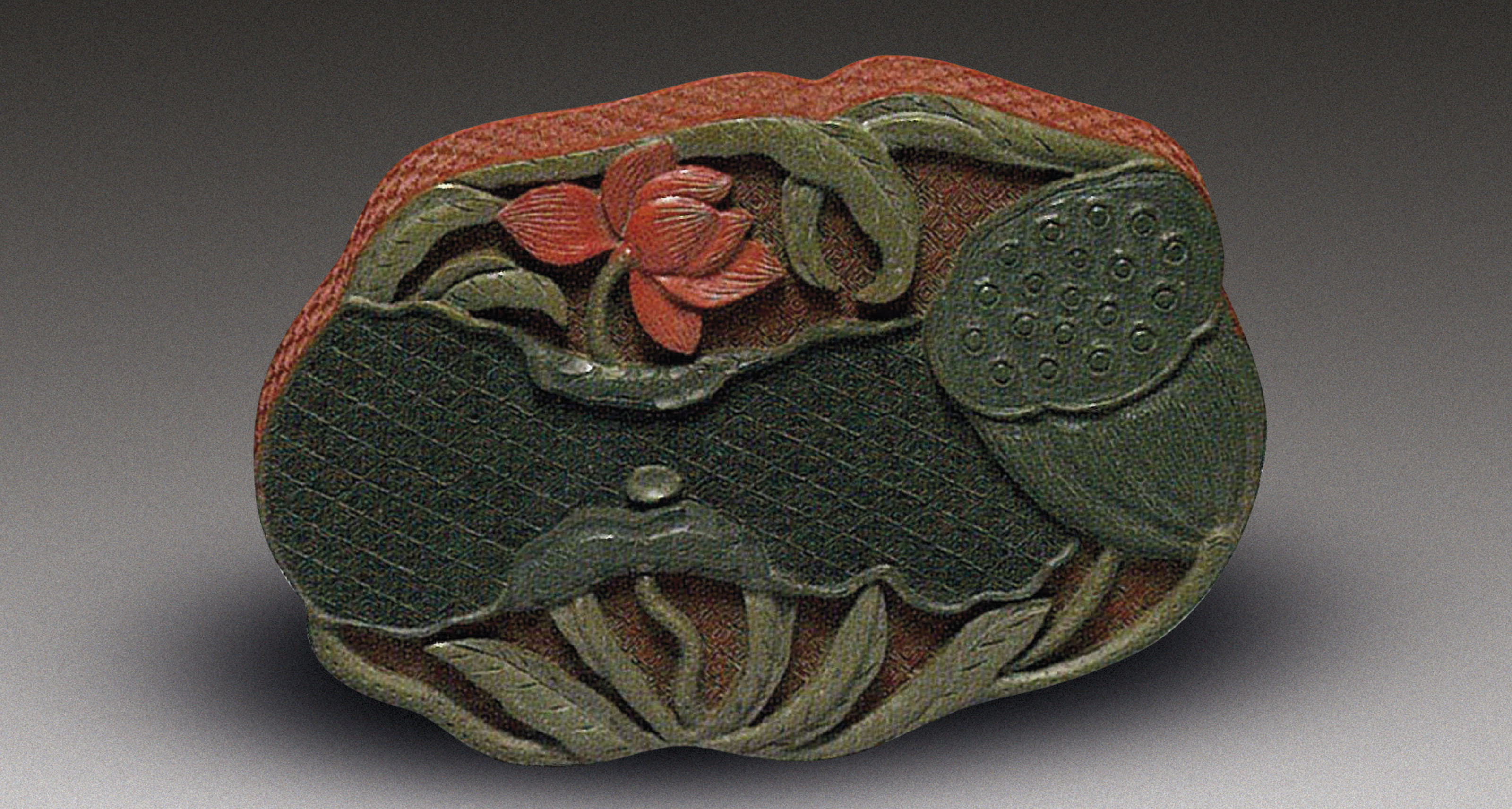 A CARVED POLYCHROME LACQUER 'L