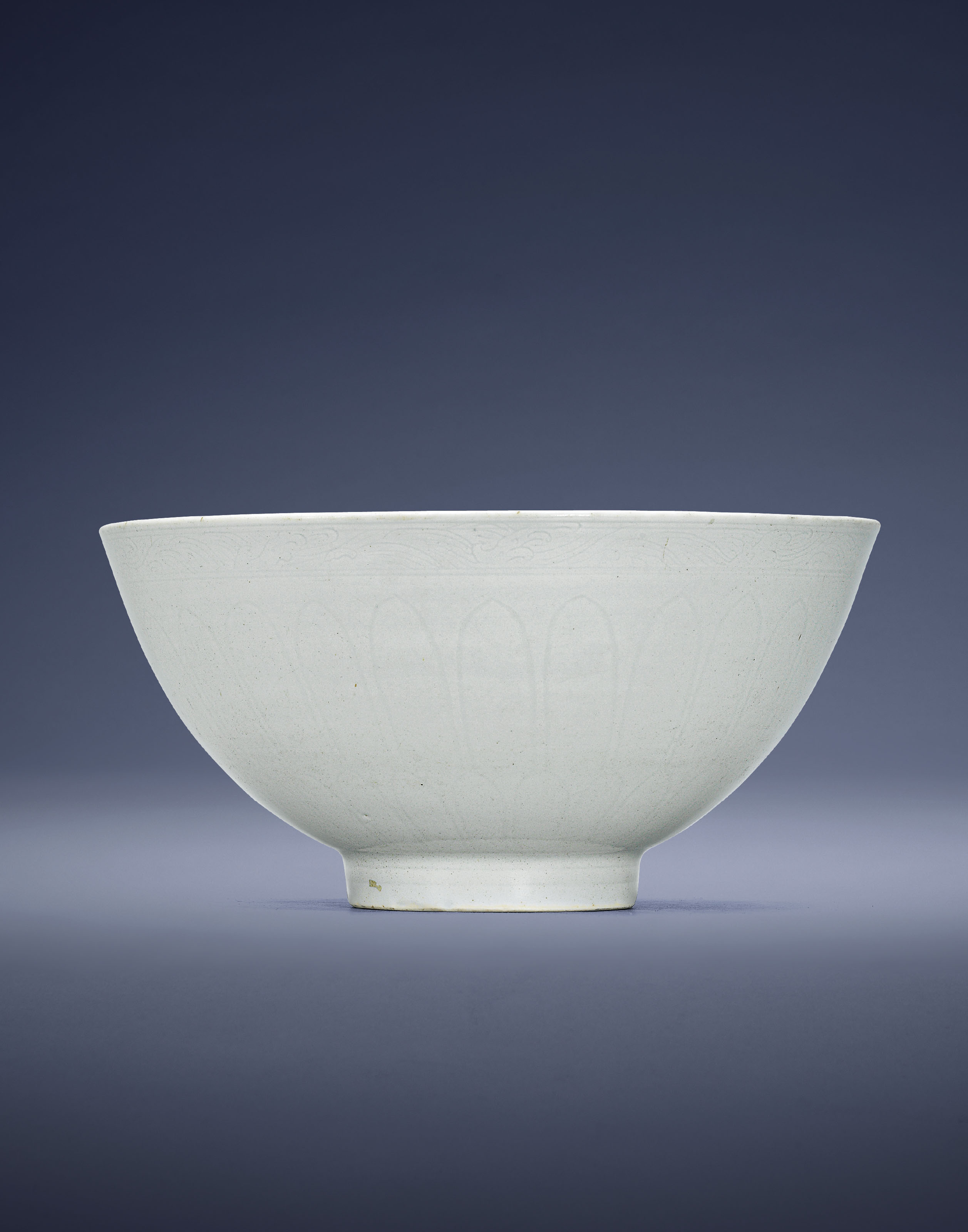 AN EARLY MING WHITE-GLAZED ANH