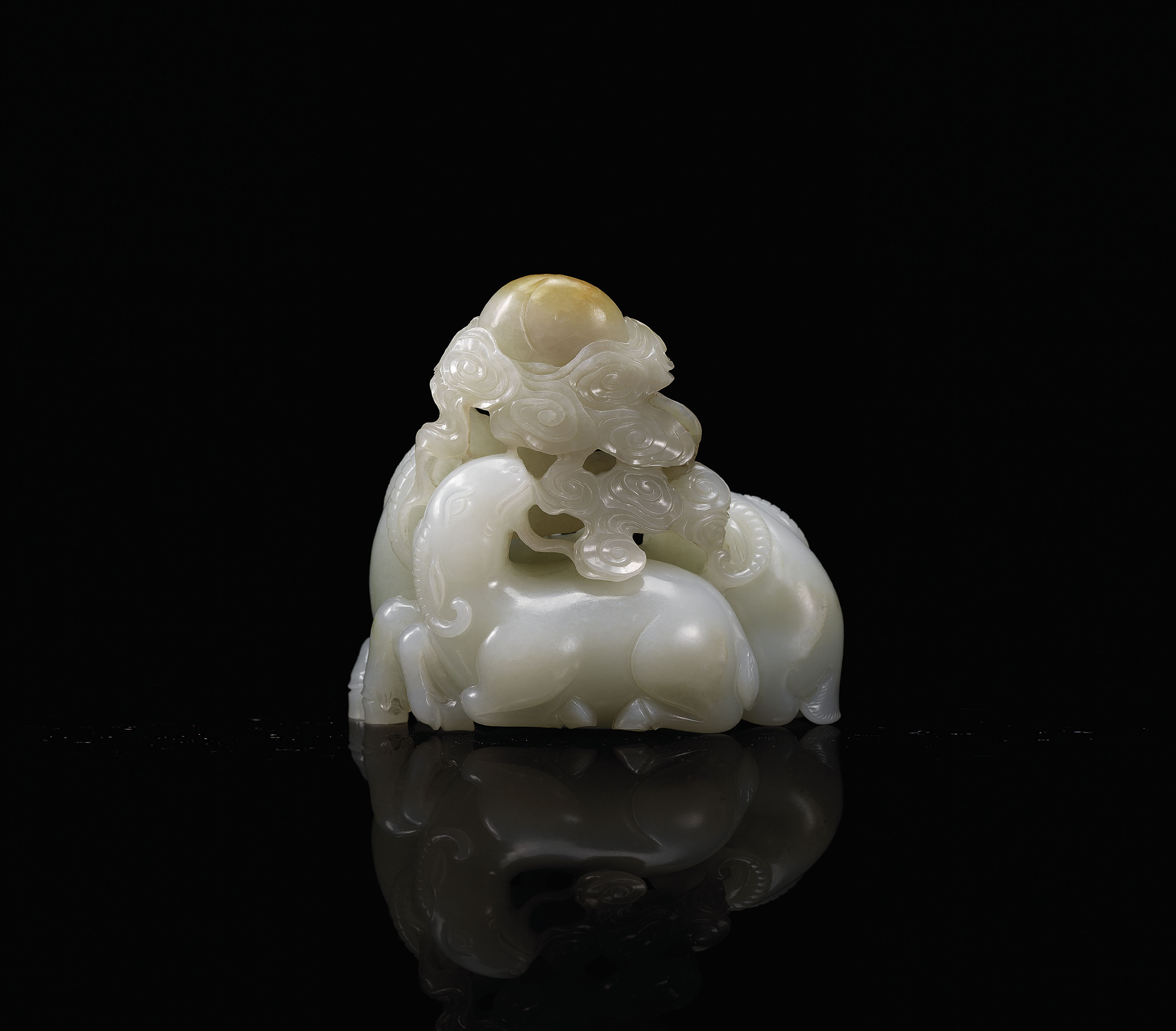 A WHITE JADE CARVING OF A 'THR