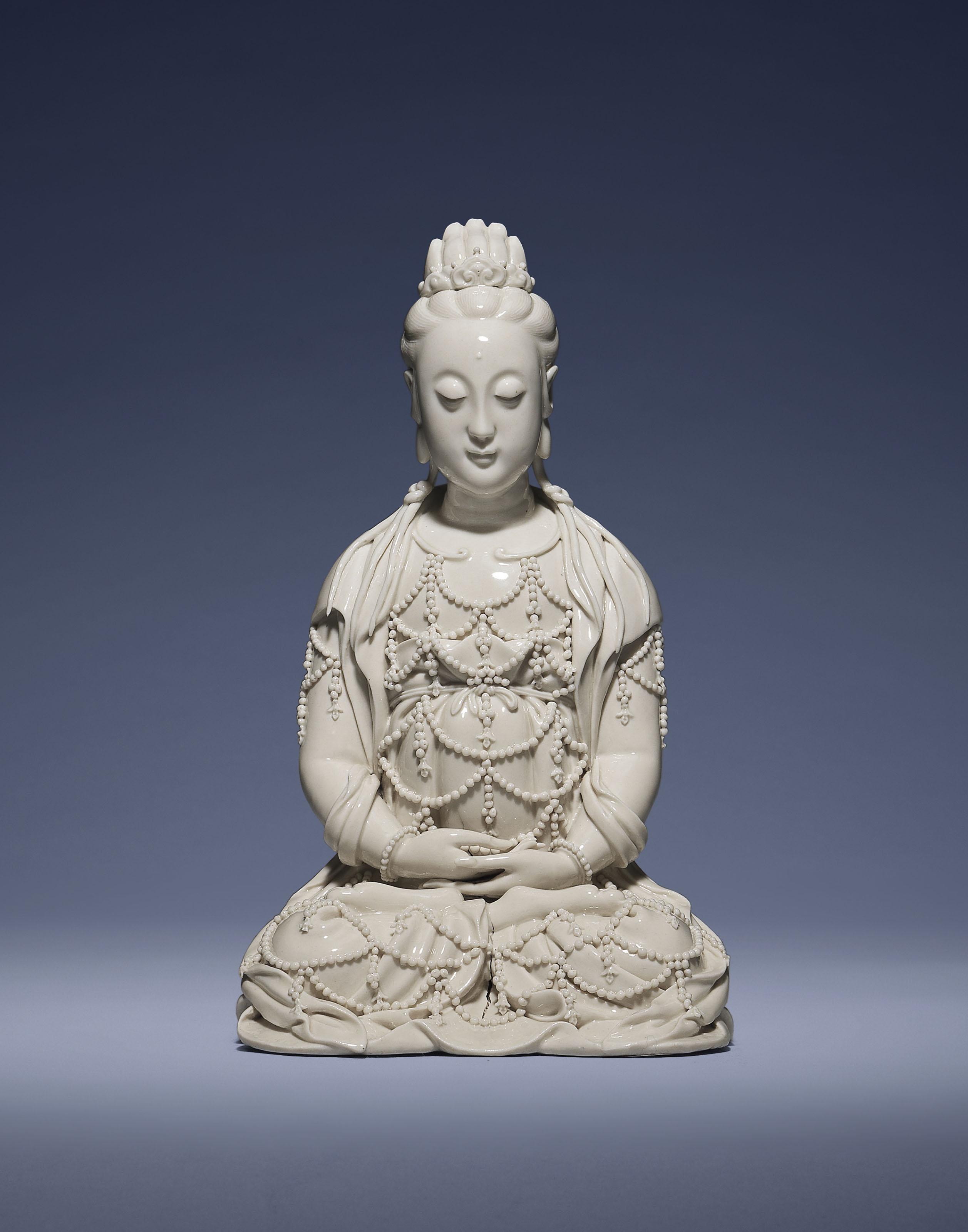 A DEHUA SEATED FIGURE OF XIWAN