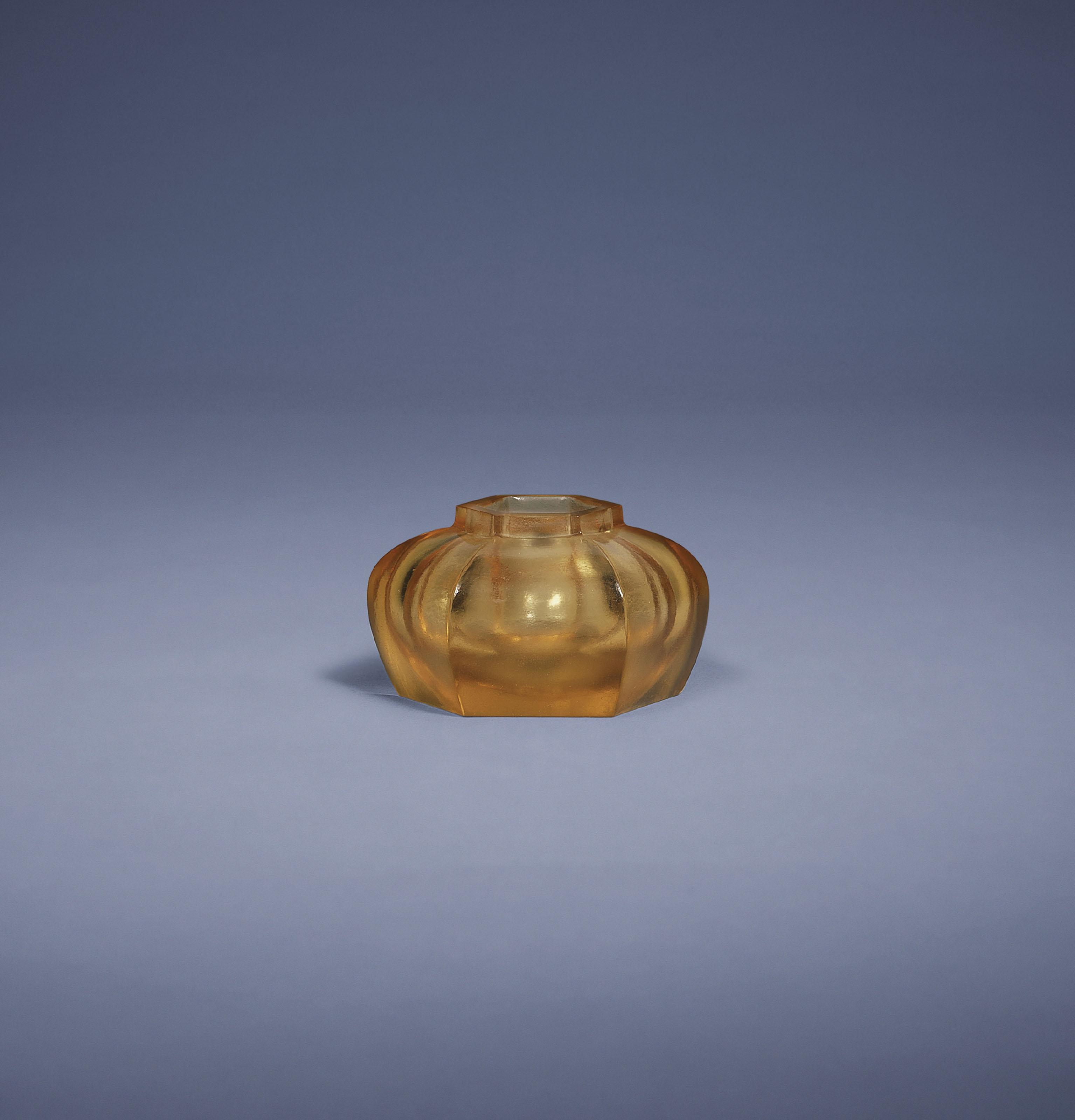 A SMALL TRANSPARENT AMBER GLAS