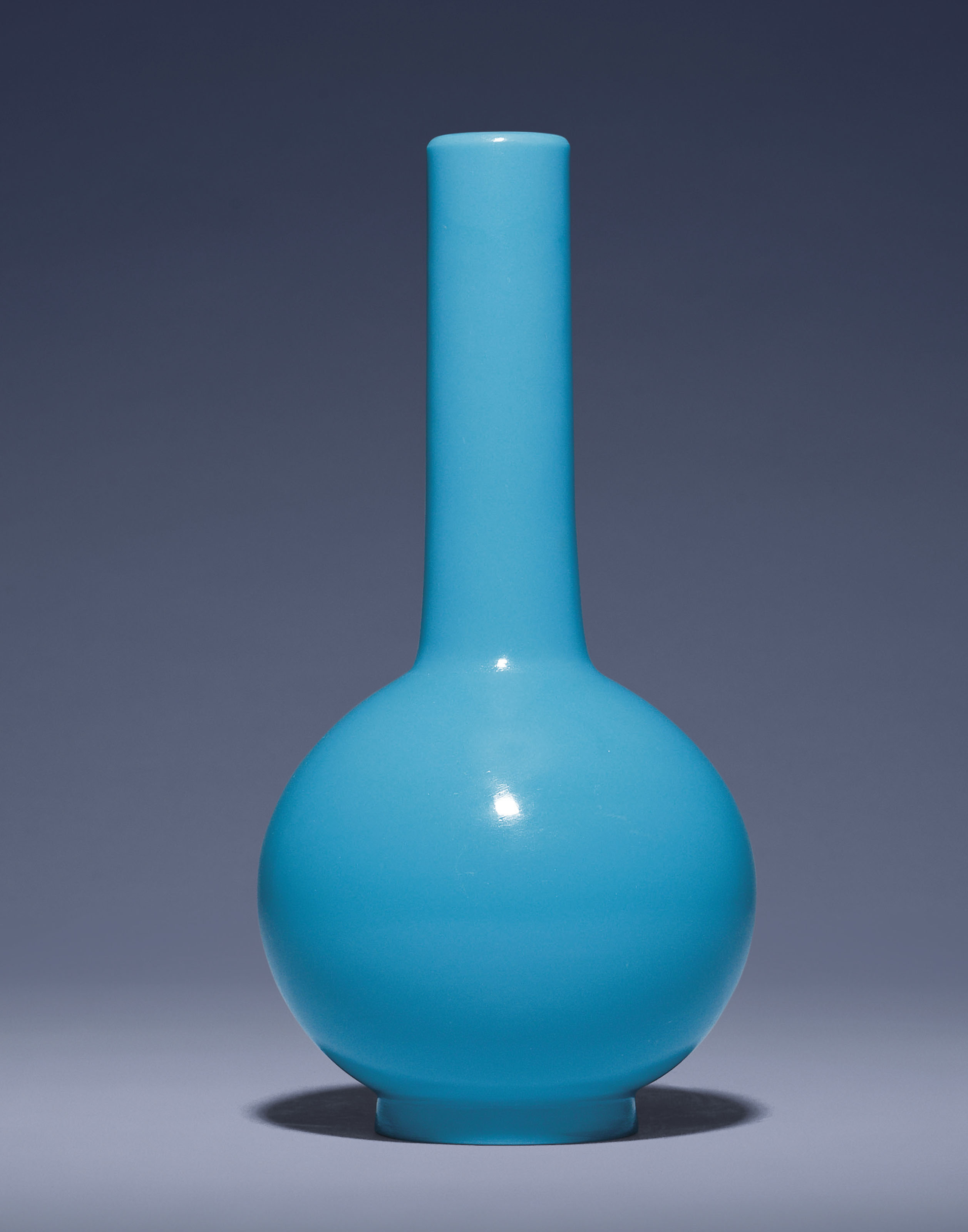 A BLUE GLASS BOTTLE VASE