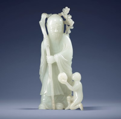 A WHITE JADE CARVING OF 'SHOUL