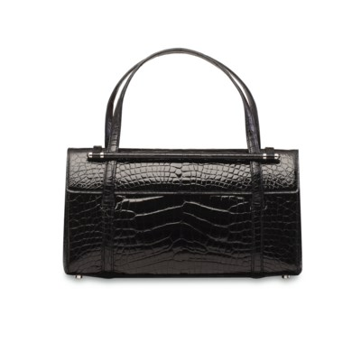 A SHINY BLACK CROCODILE BAG WI
