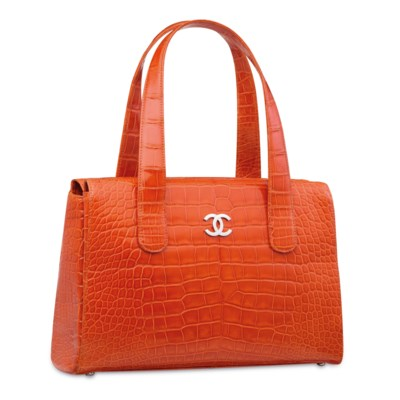 A SHINY ORANGE CROCODILE TOTE