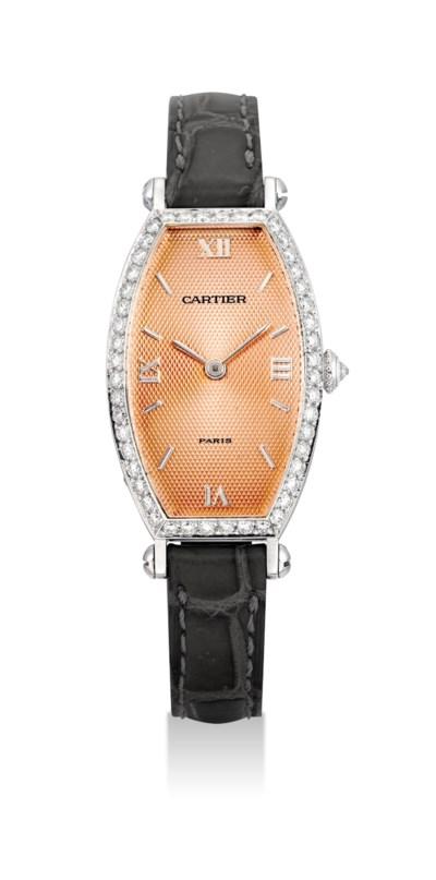CARTIER. A LADY'S FINE 18K WHI
