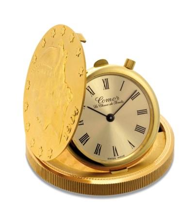COMOR. AN 18K GOLD TWENTY DOLL