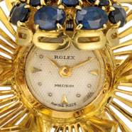 ROLEX. A LADY'S 18K GOLD AND S